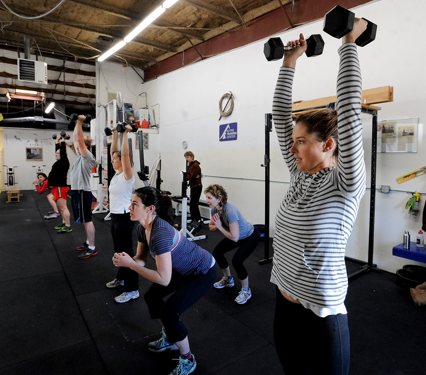 "Katie Kelly, right, begins a routine with other members of Connie Sciolino's training class at Alpine Training Center in Boulder.<br /> For more photos and a video, go to  <a href=""http://www.dailycamera.com"">http://www.dailycamera.com</a>.<br /> Cliff Grassmick  / January 2, 2013"