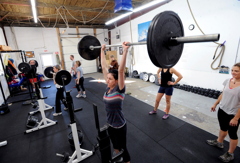 "Rebecca Yarmuth, center, lifts weights with other members of Connie Sciolino's training class at Alpine Training Center in Boulder.<br /> For more photos and a video, go to  <a href=""http://www.dailycamera.com"">http://www.dailycamera.com</a>.<br /> Cliff Grassmick  / January 2, 2013"