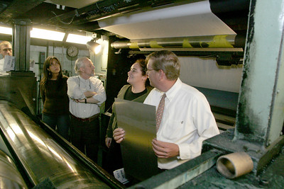 25APR06   Elyria Chronicle Telegram  publisher A. Cooper Hudnutt shows Chilean visitors, left to right Paula Viano television journalist; Berthold Bohn Sauterel Rotary Club representative ; Paola Alvarez B. a newspaper owner a press at the Chronicle.  Visible at very far right is Bill Hudnutt, Hudnutt's son and assistant to the publisher. photo by Chuck Humel