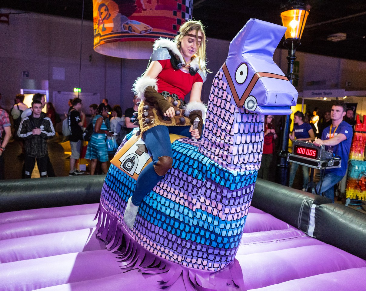 Cosplayer riding the llama at Fortnite booth
