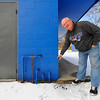 Leominster Ward 5 Councilor Rick Marchand points out, Friday, the concrete block that he had helped carry as a kid when the Leominster National Little League field concession stand was being built.<br /> SENTINEL & ENTERPRISE / BRETT CRAWFORD