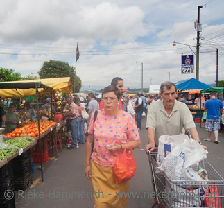 SAN JOSE, COSTA RICA - AUGUST 31: Mature couple shopping on farmer's market in San Jose, Costa Rica on August 31, 2008. Farmer's markets are a traditional way of selling agricultural products.