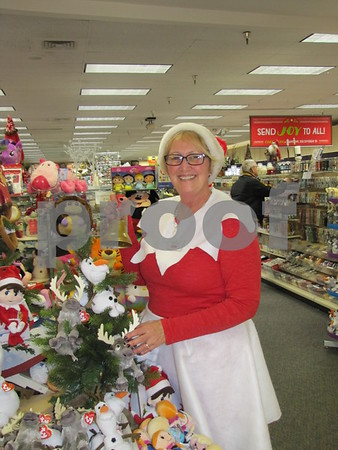 "Dee Dee ""Snow"" Burbank was dressed as an elf while working at the Hallmark store in the Crossroads Mall on Saturday."