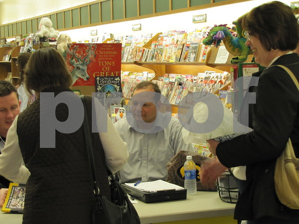 """Keith Wendell, one of the authors of """"Growing Up Hawkeye"""", at the book signing."""