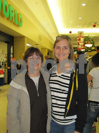 """Martha Pressler with her daughter Sheri Hofhuis at the book signing of """"Growing Up Hawkeye""""."""