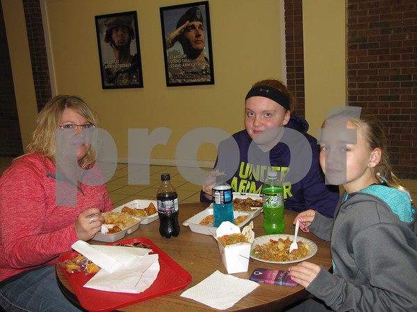 Liz Smith, Gracie Smith, and Randi Sue Welch enjoy lunch at the Hunan King inside the Crossroads Mall.