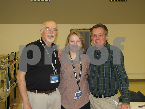 Sears store employees Mike Moore, Rose Gammello, and Randy Lohmeier pose for a photo while working Saturday.