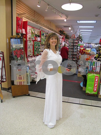 Kim Jorgenson was dressed as an angel while working at the Hallmark store in the Crossroads Mall on Saturday.