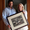 Jay Dewing and his mother, Lynn Maddock, on May 16, 2011, hold a photo of Briggs Cunningham and some of his racing cars. She is the daughter of that Cunningham and Jay is his grandson. (www.palmbeachpost...)