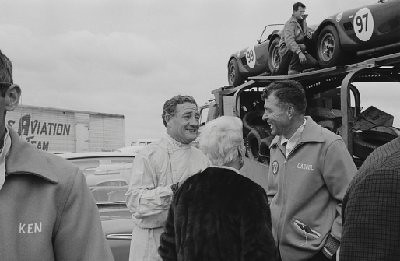 Bridgehampton Double 500, 1963. Briggs Cunningham (left) and Carroll Shelby (right). In the background is race number 99 and 97, both Shelby Cobras. (Photo credit: Karl Ludvigsen Photograph Collection, Revs Institute)