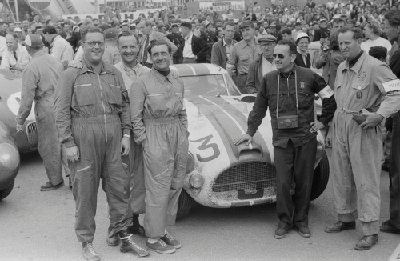 24 Hours of Le Mans, 1953. Post-race scene, Car Number 3, the Cunningham C-4RK, left to right: Bill Spear, co-driver (race suit, glasses); John Gordon Bennett, co-driver (race suit, checked shirt); Briggs Cunningham, co-driver (race suit, hands in pockets); Alfred Momo, team manager (hat, glasses, standing at left door); Phil Walters, co-driver (race suit, sunglasses, camera around neck); Charles Moran, co-driver (race suit, holding helmet in left hand). (Photo credit: George Phillips Photograph Collection, Revs Institute)