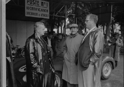 Scrutineering at 24 Hours of Le Mans, 1955. Briggs Cunningham (center) and William Spear (right) of the Cunningham team at Le Mans registration. Alfred Momo is seen in the background (trenchcoat).  (Photo credit: George Phillips Photograph Collection, Revs Institute)