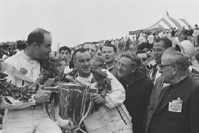 Bridgehampton 200 USRRC, 1966. Left: Overall winner Jerry Grant (Lola T70) Right: Scooter Patrick, under 2 liter winner (Porsche 906). Briggs Cunningham is next to S. Patrick. (Photo credit: Karl Ludvigsen Photograph Collection, Revs Institute)