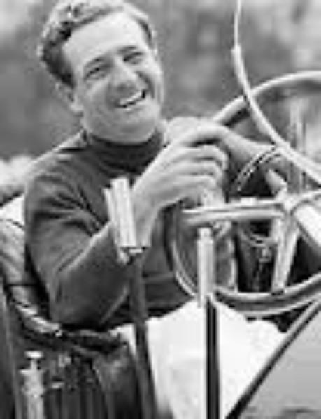 "Briggs Cunningham, ""Mr. C,"" at wheel of vintage car during 1952 sports car races in streets of Bridgehampton, NY. (petelyons.photosh...)"