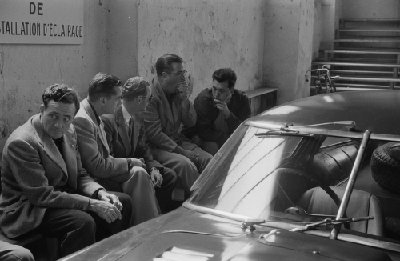24 Hours of Le Mans, 1953. Seen during scrutineering - waiting patiently at the lighting check station beside works Ferrari 340MM Berlinetta are L to R Briggs Cunningham, Phil Hill, Ferrari private owner/driver Tom Cole, and Bill Spear. Cole would lose his life in the 16th hour of the race that weekend. (Photo credit: George Phillips Photograph Collection,  Revs Institute)