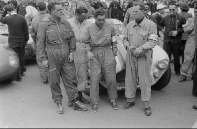 24 Hours of Le Mans, 1953. Post-race scene, (Car Number 3), the Cunningham C-4RK, left to right: Bill Spear, co-driver (race suit, glasses); John Gordon Bennett, co-driver (race suit, looking down); Briggs Cunningham, co-driver (race suit, exhausted); Charles Moran, co-driver (race suit, holding helmet). (Photo credit: George Phillips Photograph Collection, Revs Institute)