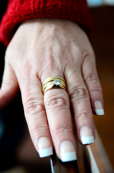 Cynthia Donovan Schuster of Townsend wears her 4 rings, Friday, that were found thanks to strangers with a metal detector after they saw her plea for help in the Townsend Times.<br /> SENTINEL & ENTERPRISE / BRETT CRAWFORD