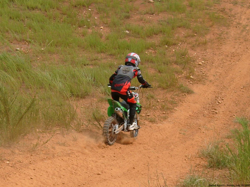 On his way back down from his first big hill climb, July 09