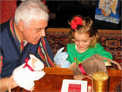 Abe Assily and his granddaughter, Kara, play with puppets in December 2009.