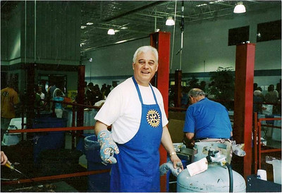 Abe Assilly, a past president of the Elyria Rotary Club, loved to cook steaks for the organization's annual steak fry.