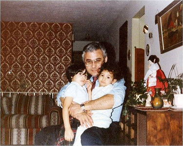 Abe Assily holds his eldest daughters Lani (left) and Rania (right), in 1981.