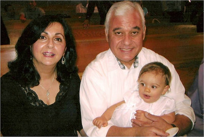 Proud grandparents, Laila and Abe Assily, at the baptism of their first grandchild, Kara Alexis Randall, at St. Jude Catholic Church in Elyria in 2006.