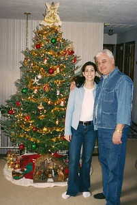 Abe Assily, right, with daughter, Lani, at Christmas 2005.