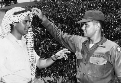 Abe Assily models his khafiyah, the traditional Palestinian headscarf, for a fellow American soldier in the late 1960s.