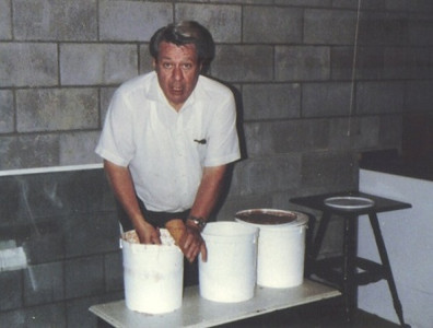 Amos Campbell scoops homemade ice cream for an ice cream cone at Mapleside Farms in Brunswick in 1984.