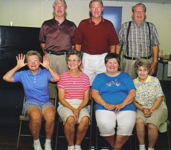 Seven Campbell siblings: Front row from left, Roberta, Joan, Jane and Margaret; Standing from left, Fred, Wayne and Amos.
