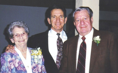 Freda Campbell, left, and her husband, Amos, right, are shown with their son, Mike, at their 50th wedding anniversary celebration.