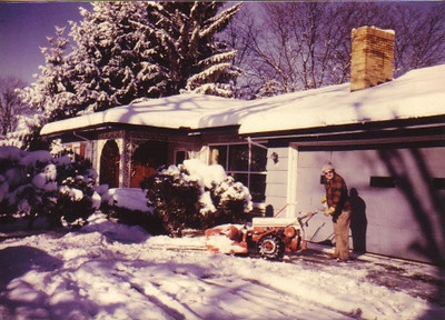 Amos Campbell clearing snow from the driveway of his home on Brookside Parkway in Middleburg Heights in the 1980s.