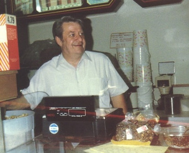 Amos Campbell handles counter duties at one of his Karmel Korn franchises in the 1980s.