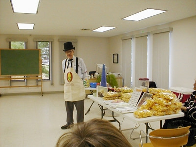 Amos Campbell tells an audience at the Swanton (Ohio) Public Library about popcorn.