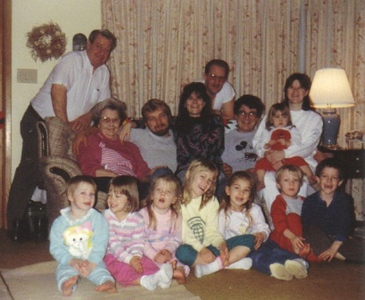 Amos Campbell, top left, standing behind his first wife, Freda, celebrate the Christmas holidays with family in 1989.