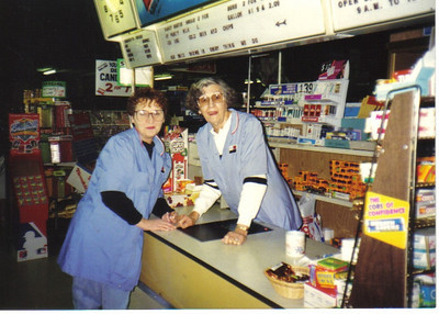 Ann Brand leans over the counter at Discount Drug Mart in Westlake in the late 1980s to pose with co-worker Janet Hammer.