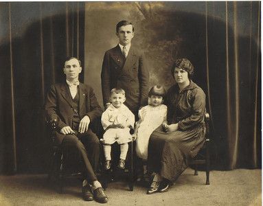 Ivka family portrait, 1920s: Seated from left to right, Mike (father), Paul (son), Anna (daughter), and Katherine (mother); Standing is John Mikulic, Katherine's son from her first marriage.