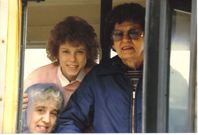 Ann Brand, right, peers out of the door of an Avon school bus with Lois Roling, left, and Bobbie DeChant, center, in the 1980s.