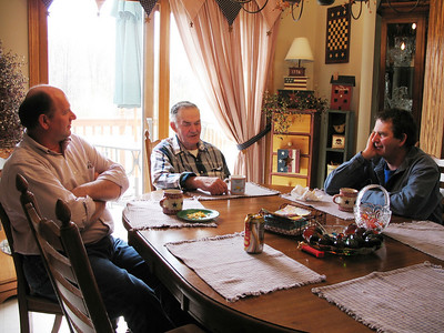 Avery Wilcox Sr., at the head of the table, chats with his eldest and youngest sons, Avery Jr. (lef), and Greg (right), in 2006.(Photo courtesy of the family.)