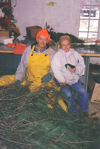 Avery Wilcox Sr. and his wife, Betty, turned pine branches into pine roping and wreathes, which they sold at the Wilcox Christmas Tree Farm gift shop. (Photo courtesy of the family.)