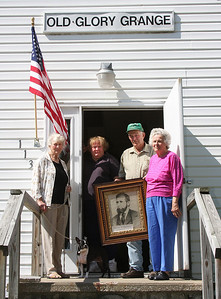(Chronicle File Photo by Bruce Bishop) Avery Wilcox, holding a portrait of Old Glory Grange founder Oliver H. Kelley, joins fellow Grange members (from left), Margie Lilly, Darlene Leissa and Coleen Tompkins, outside the Grange building in 2007. Old Glory Grange has since dissolved due to declining membership.
