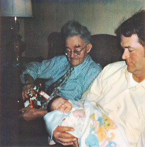 Avery Wilcox Sr. holds his granddaughter Melissa with his father, Albert Wilcox, sitting next to him in December of 1975. (Photo courtesy of the family.)