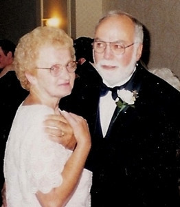 Barb and Dick Baldwin get affectionate at their son Rob's wedding.