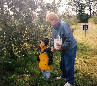 Barb Baldwin and her grandson Brandon pick apples at Miller's Apple Hill at Routes 113 and 60 in Henrietta Township in 2006.