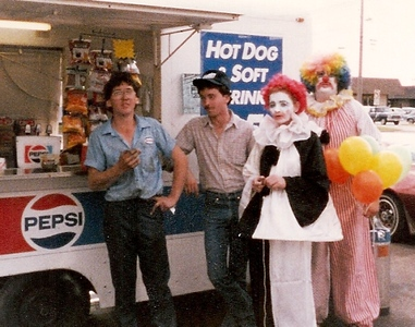 To celebrate the completion of the remodeling of the Sohio station she managed in Amherst, Barb Baldwin dressed in a black-and-white clown costume, but stuck with her signature red hair, albeit a clownish shade of red. With her from the left are sons Rob and Ron and store employee Kevin Hicks, also dressed as a clown.