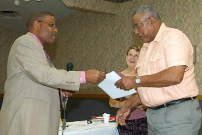 Billy Ray, right, receives an award at a Kiwanis gathering.