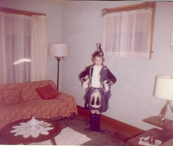 Carol Street shows off her Scottish dance costume around 1960.