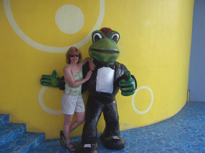 Carol Fankhauser poses with Señor Frog at a restaurant bearing his name in Mexico.