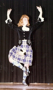 Carol Fankhauser, who was a competitive Highland dancer as a youngster living in Lorain, is shown demonstrating Scottish dancing for students in the Columbia schools.