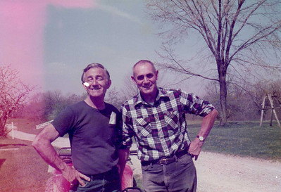 Charlie Kurtz, left, and his younger brother, William Kurz (different spelling), on the farm in Chatham Township.
